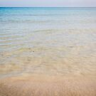 Crystal clear water on sandy beach by Sunil Bhardwaj