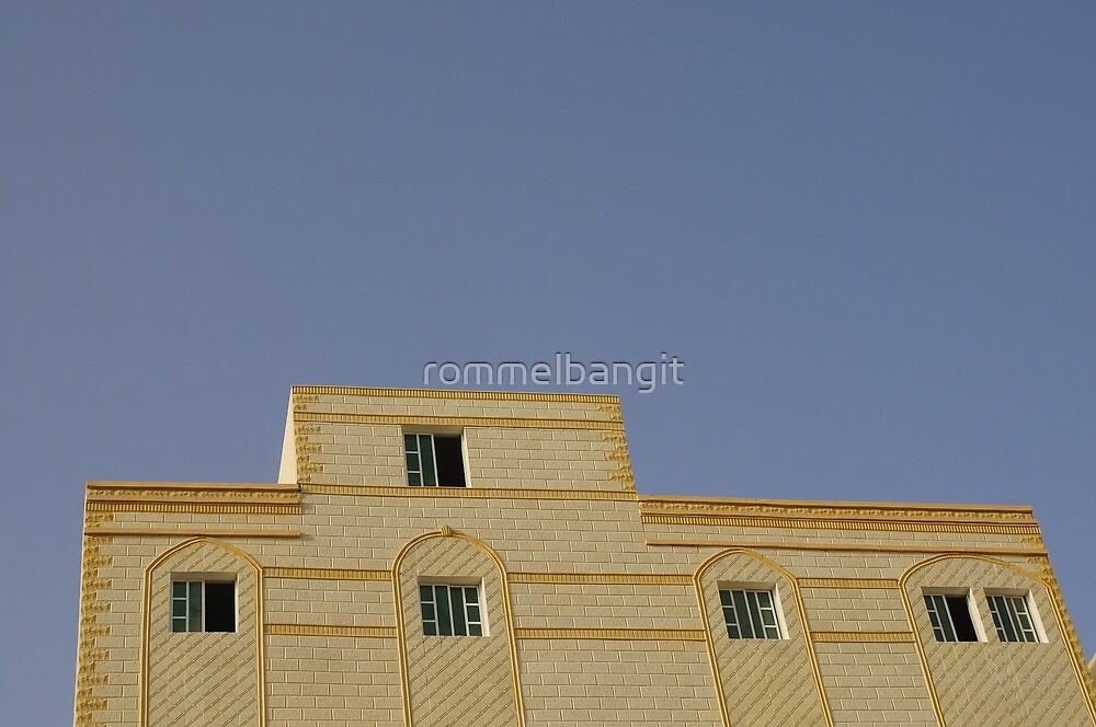 Parapet  and Windows Facade on Blue Sky by rommelbangit