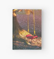 Red swing in the setting sun Hardcover Journal