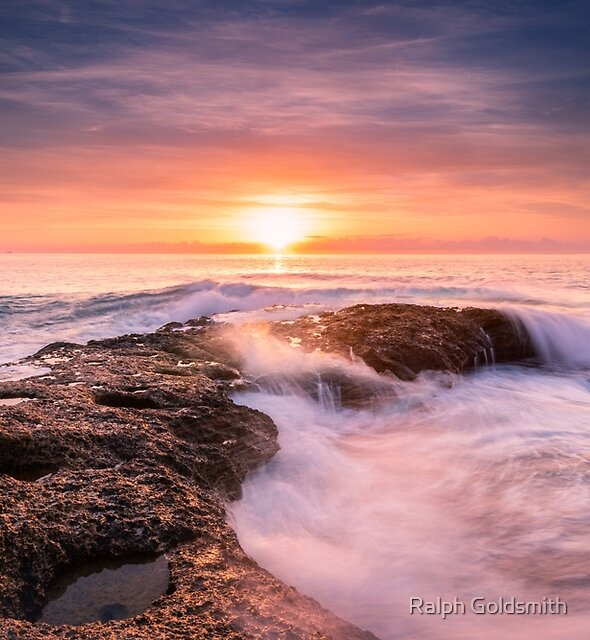 Sunrise at Llop Mari with smashing waves by Ralph Goldsmith