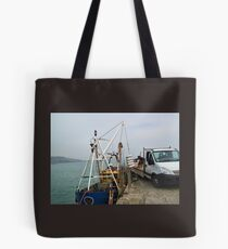 Fisherman Unloading Their Catch Tote Bag