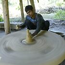Nepalese potter in Bardia by Yves Roumazeilles