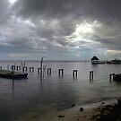 Waiting to Row...Caye Caulker, Belize by graeme edwards