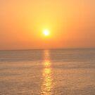 SUNRISE AT SEA by JAYMILO