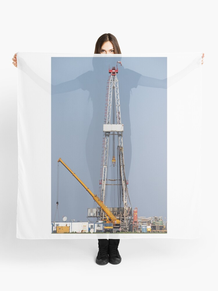 oil drilling rig and crane heavy machinery | Scarf