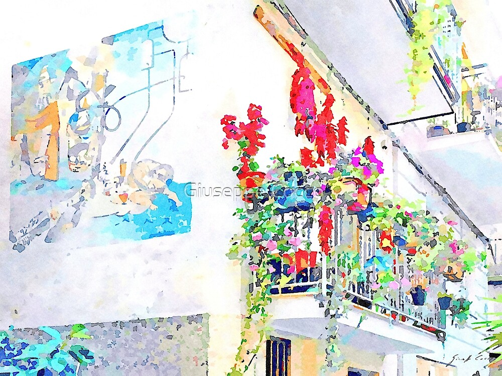 Murales and flowered balcony by Giuseppe Cocco