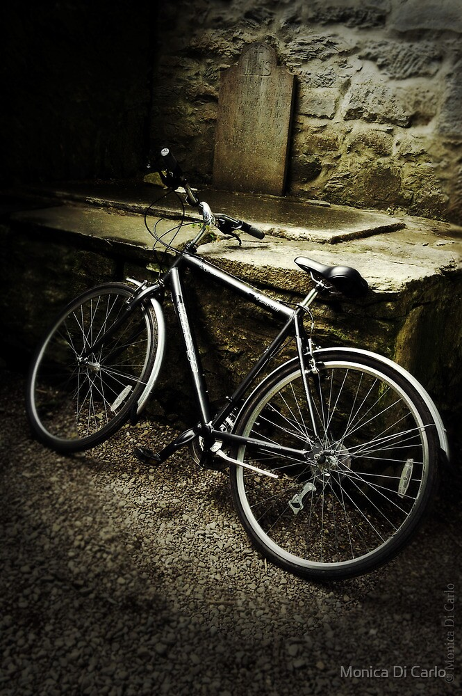 Bycicle by a tombstone, Ireland by Monica Di Carlo