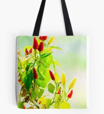 red and yellow peppers grow Tote Bag