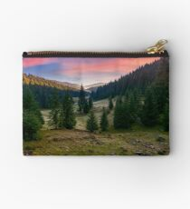spruce forest in foggy valley at reddish sunrise Studio Pouch