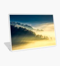 deep fog above the valley at sunrise Laptop Skin