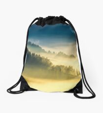 deep fog above the valley at sunrise Drawstring Bag