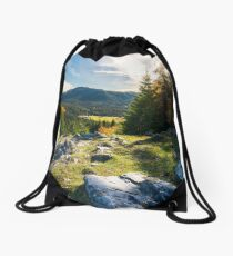 rocky cliff above the forested valley Drawstring Bag