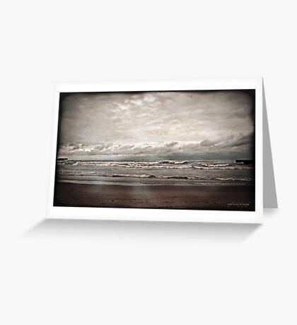 a dark day at the beach Greeting Card