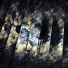 Kaleidoscope-reflections of sun and clouds in the glass facade von Peter Benkmann