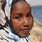 Nuba girl on the Nile by Peter Gostelow