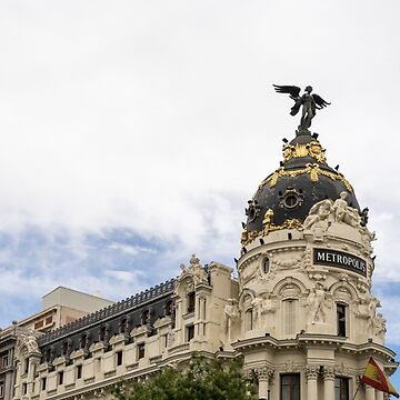 Gallivanting Around Madrid is a Pure Delight - Iconic Metropolis Building with White Clouds by GeorgiaM