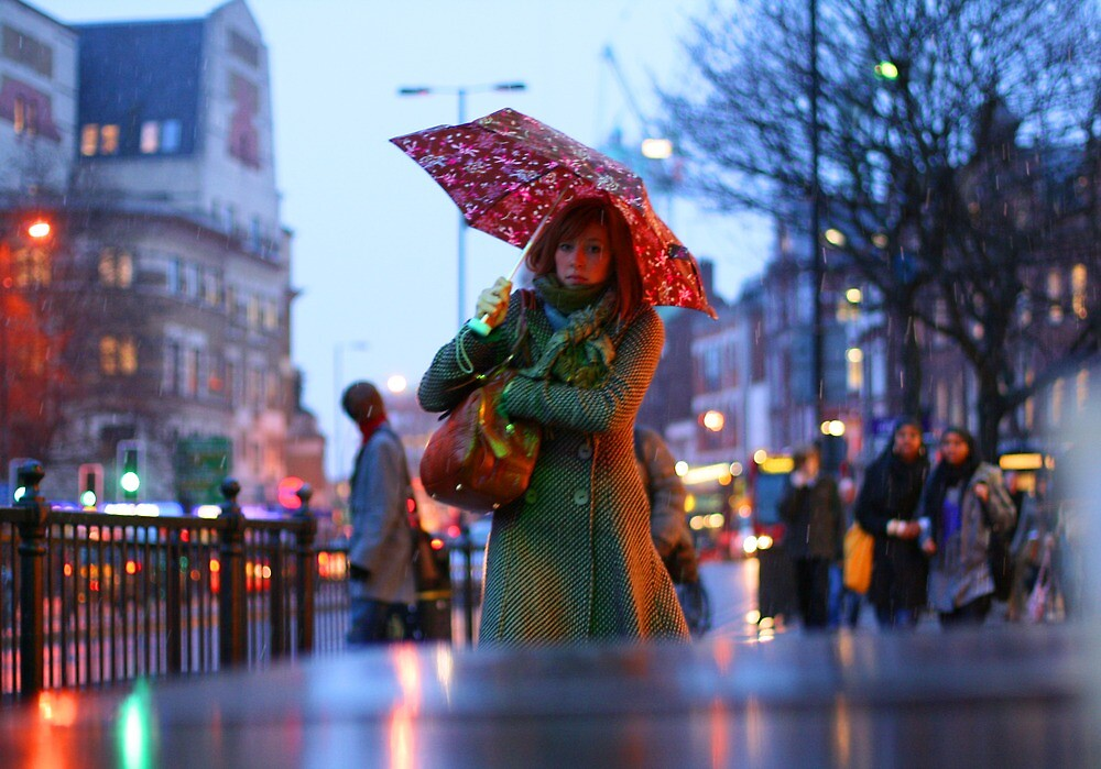 Girl walking under umbrella in the snow at Islington by cheburashka