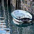 Grey Weathered Skiff Moored At The Harbour by Susie Peek