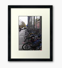 bicycles in the street Framed Print