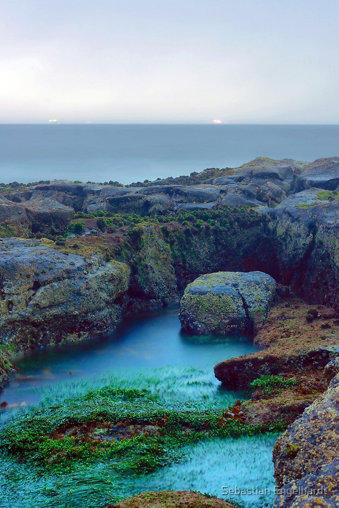 Rockpools in the rain by Sebastian Engelhardt