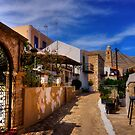 Between the Houses in Halki by Tom Gomez