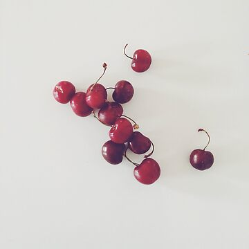 Red cherries on a white background by franceslewis