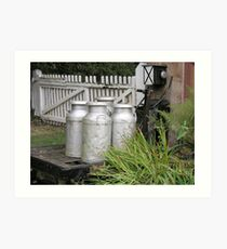 Milk churns on old English country station Art Print