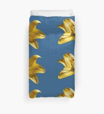 Yellow Garden Lily On Blue Background Duvet Cover
