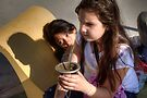 Young Girls Drinking Mate' - Argentina by Kent DuFault