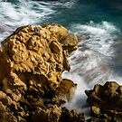 Waves on the rocks by Ralph Goldsmith