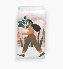 Beautiful girl with plant in pot Duvet Cover