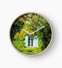 Old typical house in Provence in summer Clock