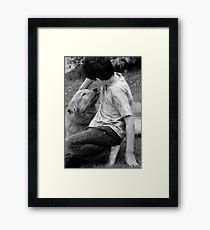 Child and dog Framed Print