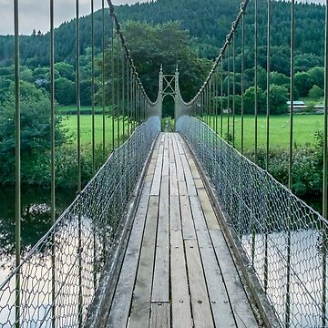 Sappers suspension bridge over the River Conwy built in 1930 and a prominent landmark in the village of Betws-y-Coed in North Wales by PhotoStock-Isra