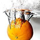 splashing orange by Denny Stoekenbroek