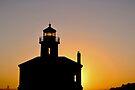 Lighthouse at Sunset. by Sun Dog Montana