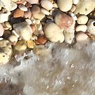 Pebbles and wave by Helen Richards