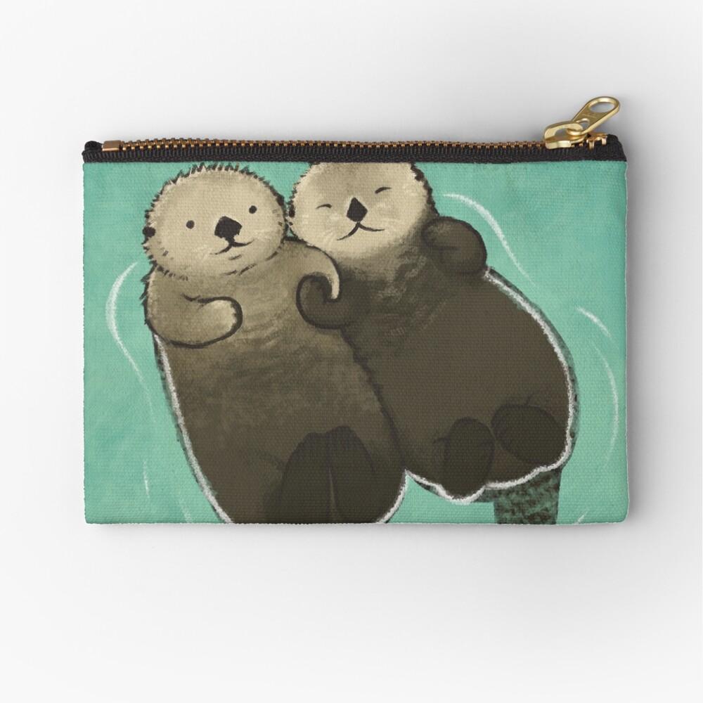Bedeutende Otter - Otter, die Hände halten Täschchen