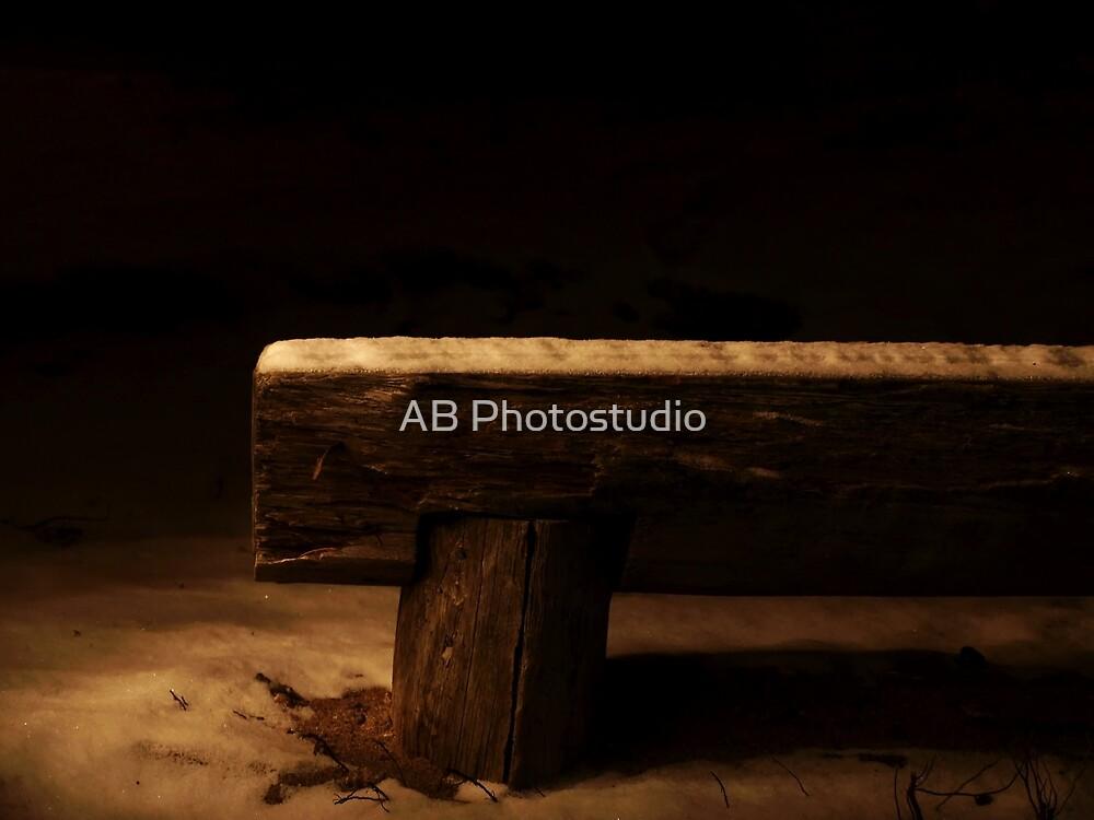 Empty bench in the darknes by Arve Bettum