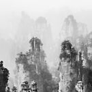 Beautiful peaks of floating mountains Zhangjiajie disappearing in milky fog Black and white art photo print by AwenArtPrints