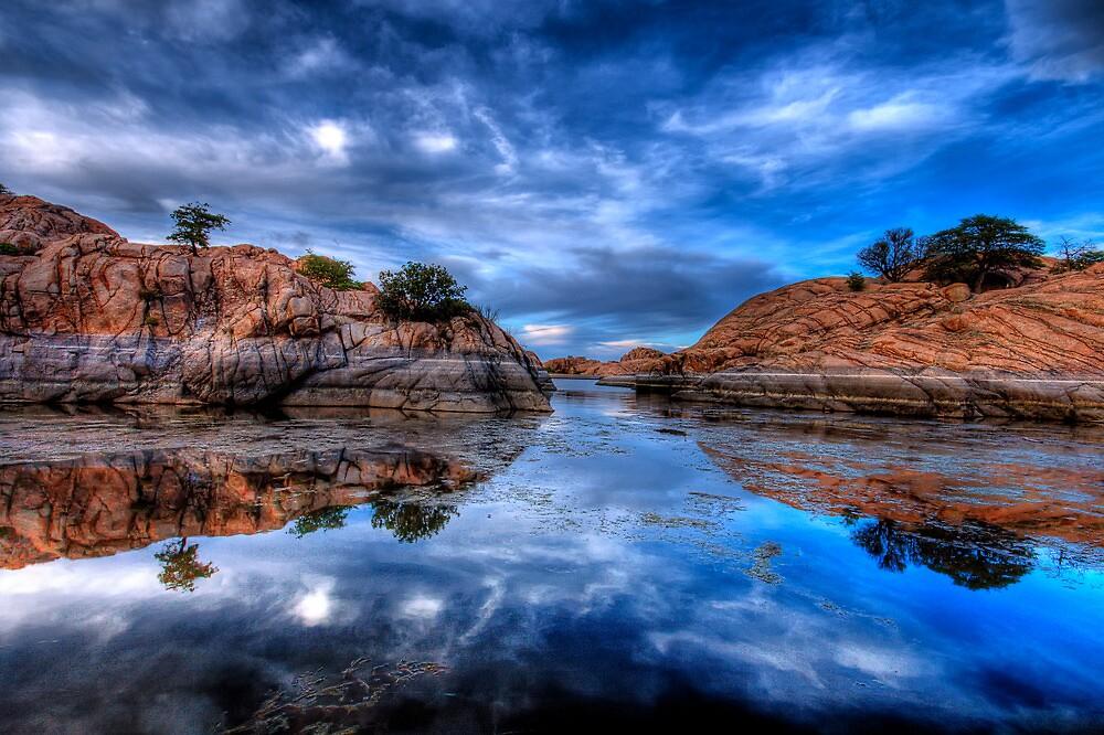 Reflection on the Rocks by Bob Larson