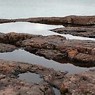Water and rock by Dan Holtmeyer