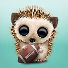 Baby Hedgehog Playing With Football by jeff bartels