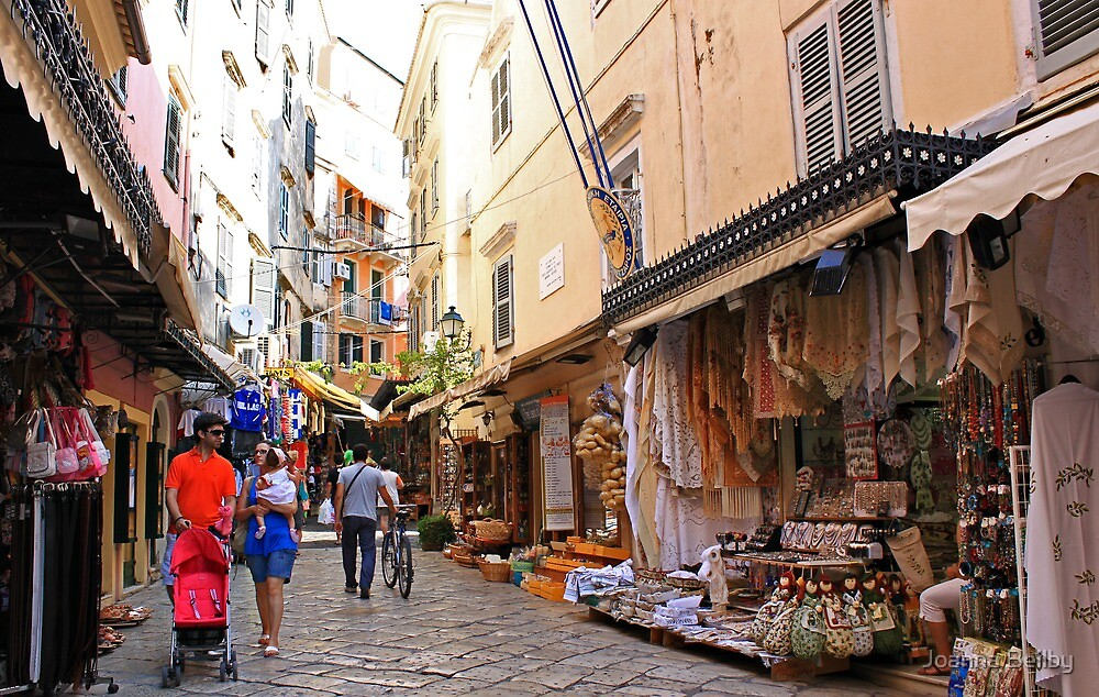 Shopping In Corfu Town, Greece. by Joanna Beilby
