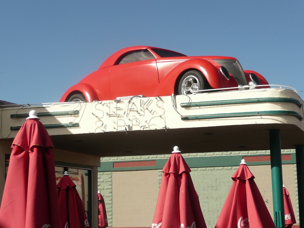 Red Car Over Steakhouse Sign, Holbrook, Arizona. by Mywildscapepics