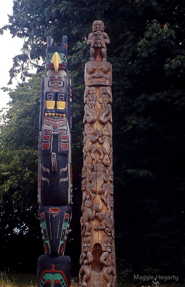 Carved Indian Totem Poles, Vancouver, Canada. by Maggie Hegarty