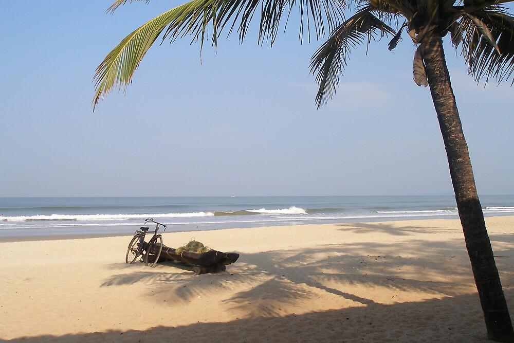 Benaulim Beach, with boat and bicycle, Goa, India by photoartindia
