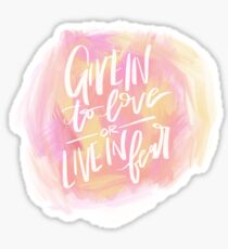 give in to love or live in fear Sticker