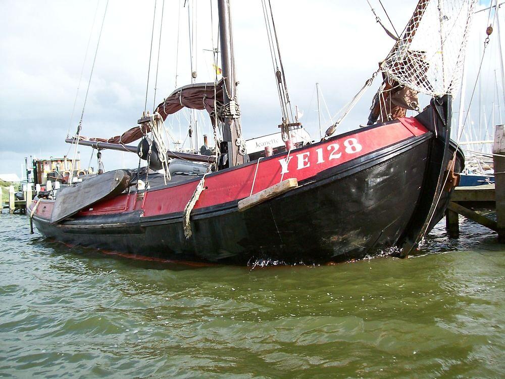 Red boat in Stavoren, Friesland by mariamagdalena