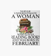 Never Underestimate a woman who loves Reading Books and was born in February T-Shirt Art Board